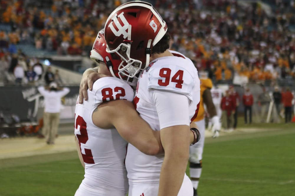 <p>Senior Logan Justus embraces fellow special teams senior Haydon Whitehead following a close game. Justus missed a field goal and an extra point Jan. 2 during the TaxSlayer Gator Bowl. </p>