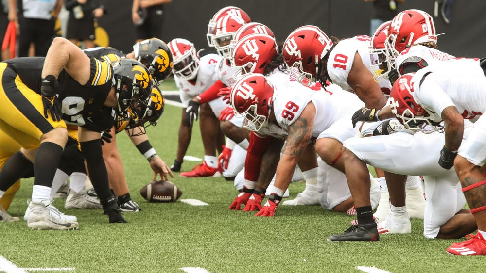 The IU defensive line prepares Sep. 4, 2021, in Kinnick Stadium in Iowa City. The Hoosiers trailed 3-31 at halftime.