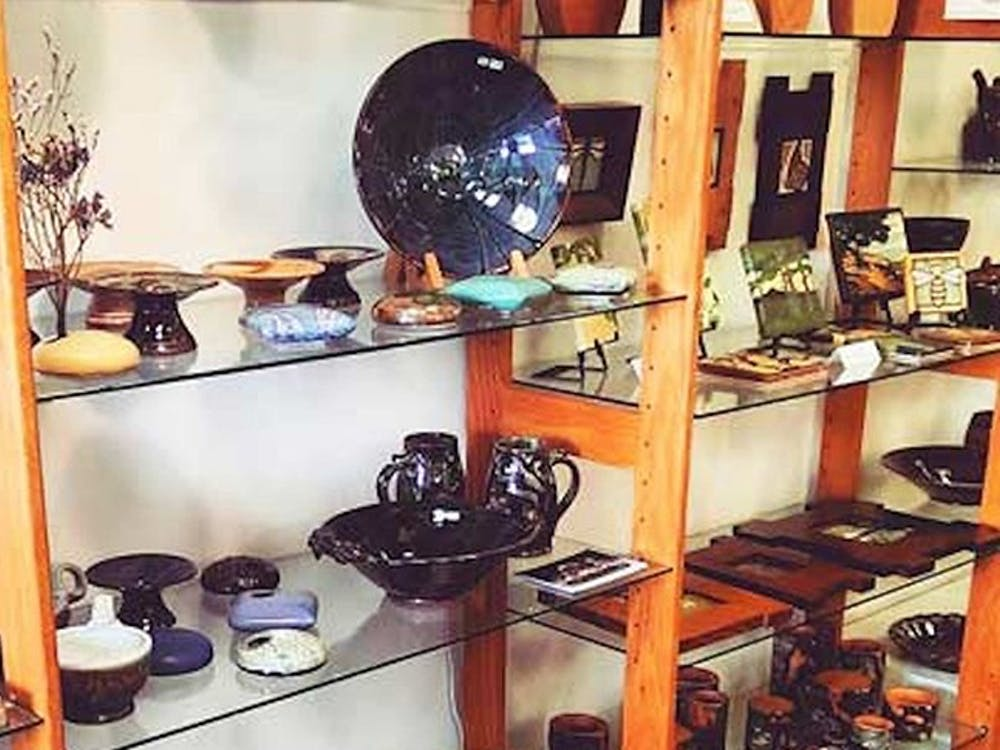 By Hand is a cooperative fine arts gallery that has been a part of the Bloomington community for over 40 years. They house a variety of artwork including paintings, jewelry, ceramics, glass, wood and ceramics.