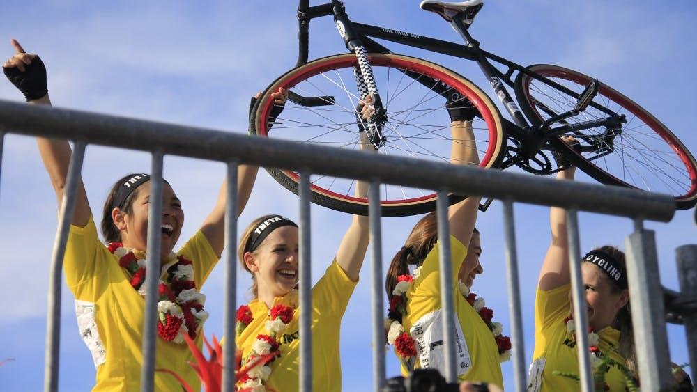 The Kappa Alpha Theta team raises its bike in celebration of its repeat Little 500 win. The women raced April 20.