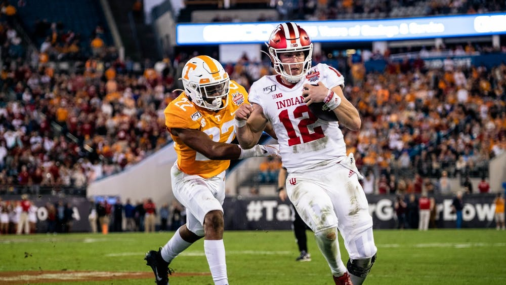Junior quarterback Peyton Ramsey runs out of bounds with the ball during the the first half of the Gator Bowl on Jan. 2. Ramsey announced Monday that he will transfer to Northwestern.