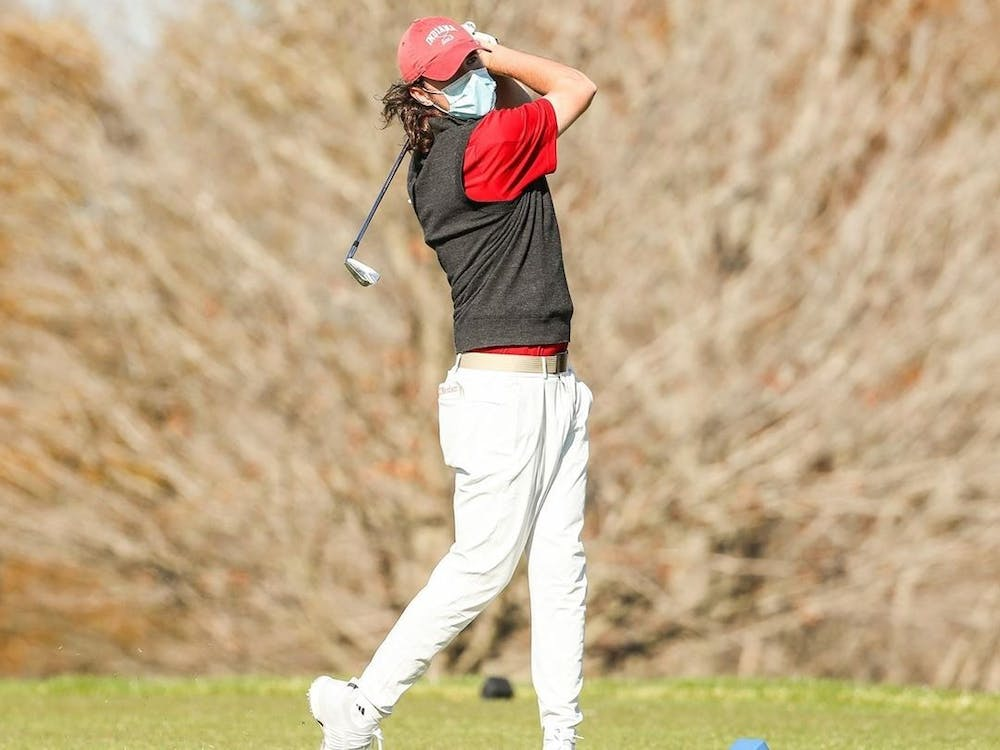 Freshman Clay Merchent swings a golf club Feb. 15 during the Mobile Bay Intercollegiate. IU men's golf will compete this weekend at the Hoosier Invitational at the Pfau Course in Bloomington