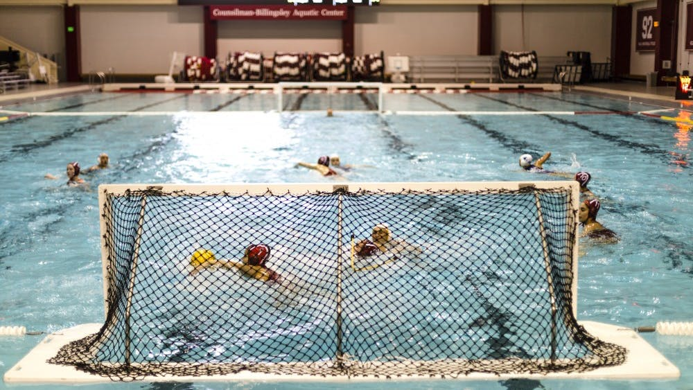 Teammates swim out for a save Jan. 28, 2018, for the IU water polo team. IU will face the University of Southern California on Saturday in Los Angeles.