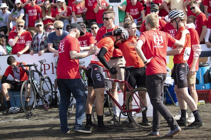 Phi Kappa Psi riders join together after they finish the men's Little 500 race April 13 at Bill Armstrong Stadium. Although the team was in the lead toward the very end of the race, it earned eighth place after its 199th lap exchange.