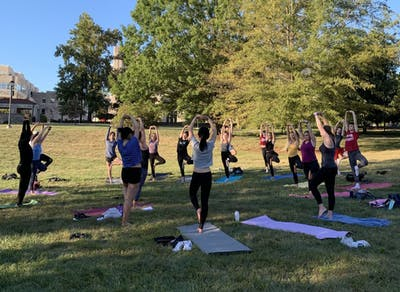 Emily Isaacman leads a yoga class for the Movement Cooperative on Sept. 26 in the Arboretum.