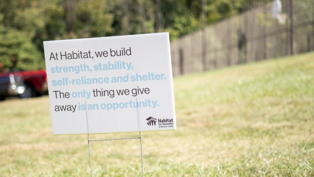 A signs sits in front of the Habitat for Humanity site Oct. 9 on North Fee Lane. Signs lined the street, explaining the organization's purpose and sponsors.