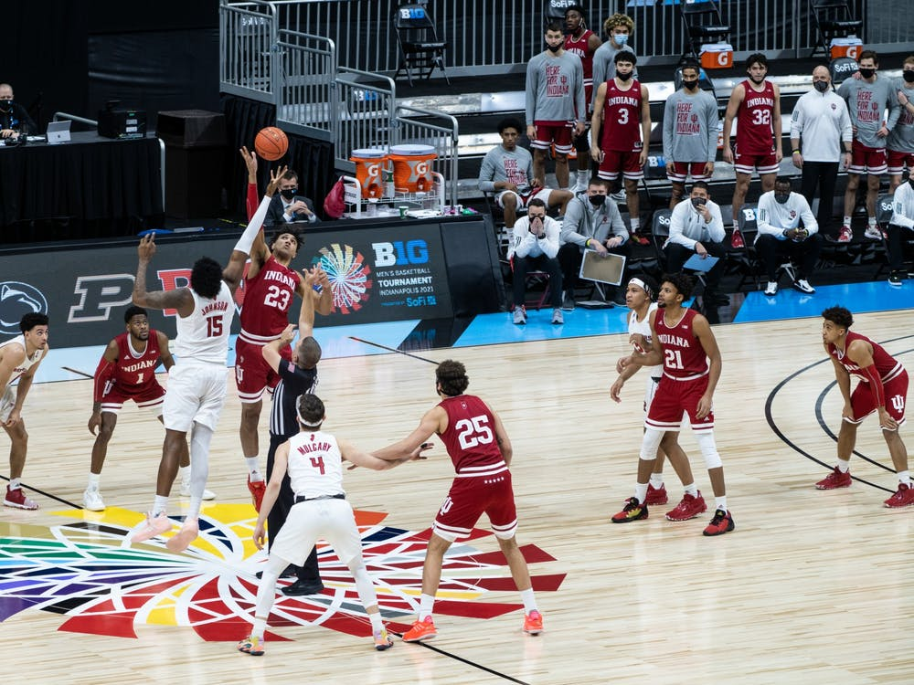 Sophomore forward Trayce Jackson-Davis jumps for the tipoff Thursday at Lucas Oil Stadium in Indianapolis. Jackson-Davis finished the game with 19 points to contribute to IU's 61-50 loss to Rutgers in the first round of the Big Ten Championships.
