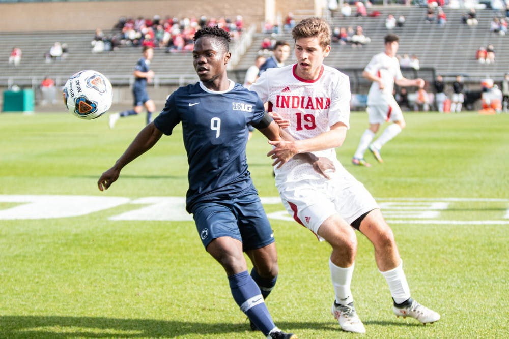 <p>Sophomore defender Brett Bebej battles for the ball against Penn State in the Big Ten Tournament Championship on April 17. IU will play the winner of the match between Milwaukee University and St. Francis College on May 2.</p>