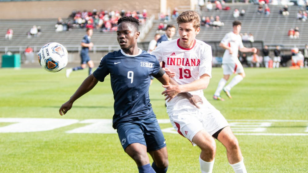 Sophomore defender Brett Bebej battles for the ball against Penn State in the Big Ten Tournament Championship on April 17. IU will play the winner of the match between Milwaukee University and St. Francis College on May 2.