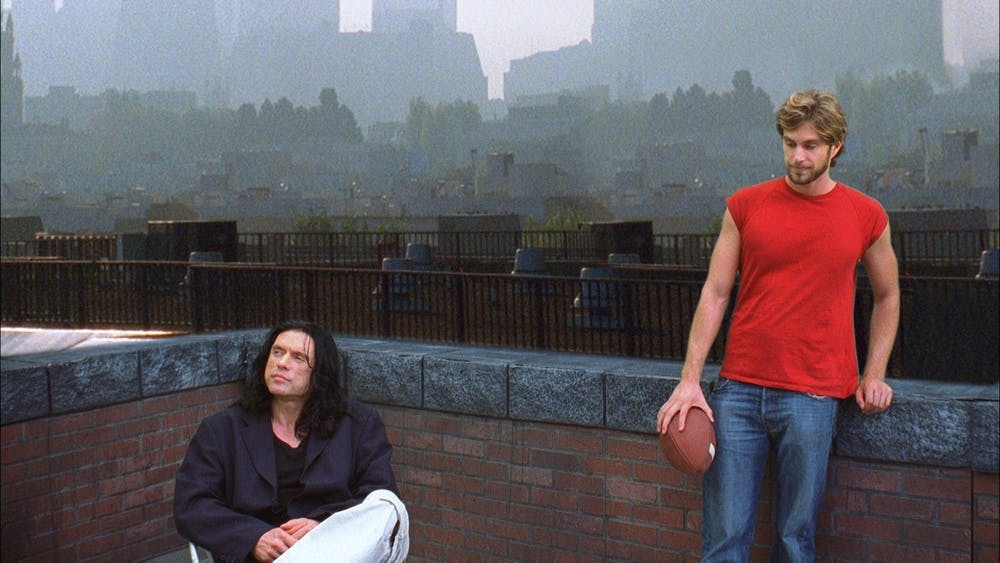 """Tommy Wiseau, left, directs and stars as Johnny in """"The Room,"""" known for its subpar acting and screenplay."""