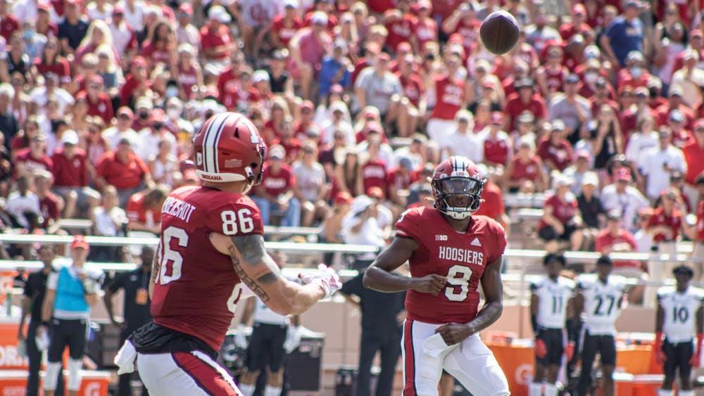 Junior tight end Peyton Hendershot prepares to catch a pass from junior quarterback Michael Penix Jr. against the University of Cincinnati on Sept 18, 2021, at Memorial Stadium. Head coach Tom Allen said Penix's X-rays came back negative.