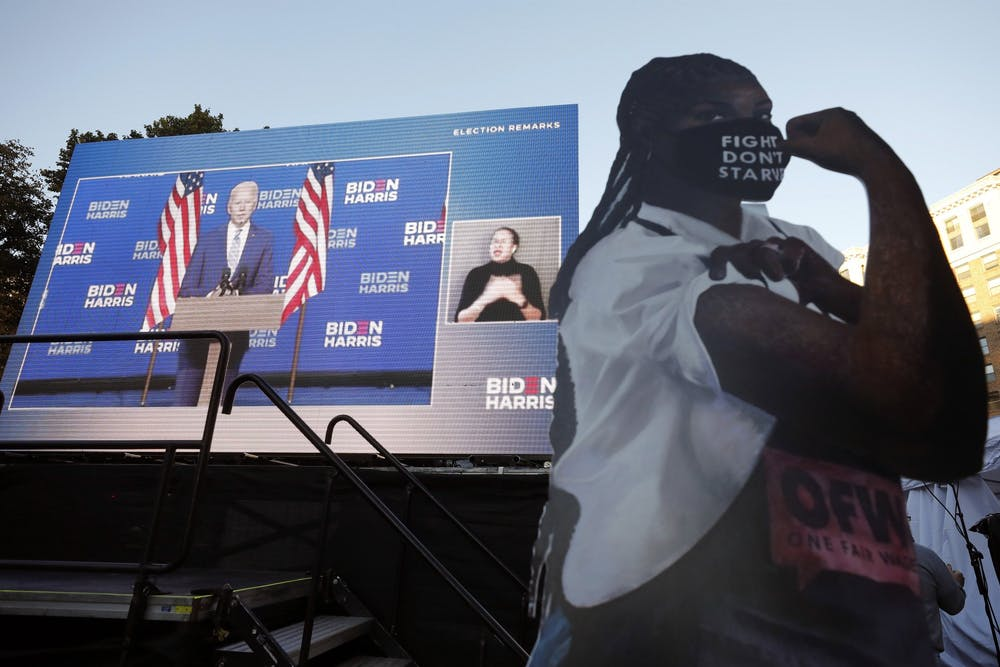 Democratic presidential nominee and former Vice President Joe Biden is seen speaking on a giant screen during a watch party of the results of the presidential election near the White House on Nov. 4 in Washington, D.C., the day after the general election.