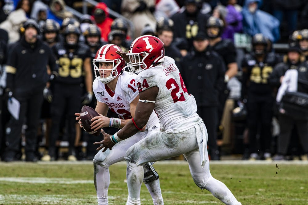 <p>Then-junior quarterback Peyton Ramsey hands the ball to then-freshman running back Sampson James in the third quarter Nov. 30 at Ross-Ade Stadium in West Lafayette, Indiana. The IU football team resumed practices July 31 after six players and staff tested positive for COVID-19.</p>