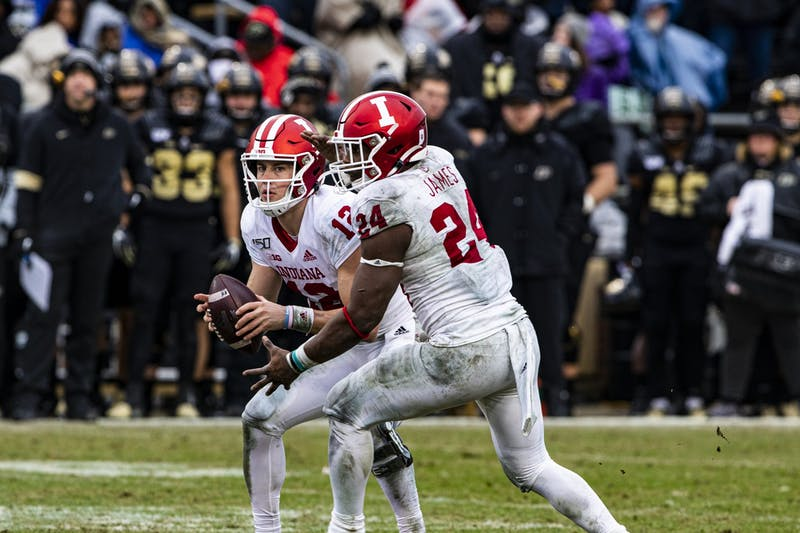 Then-junior quarterback Peyton Ramsey hands the ball to then-freshman running back Sampson James in the third quarter Nov. 30 at Ross-Ade Stadium in West Lafayette, Indiana. The IU football team resumed practices July 31 after six players and staff tested positive for COVID-19.