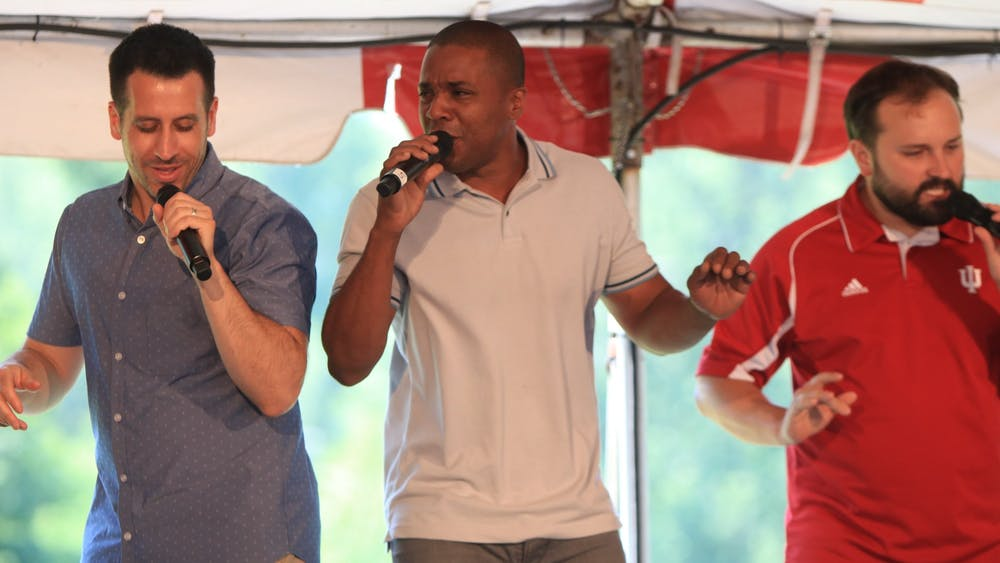 Straight No Chaser members Jerome Collins and Walter Chase dance June 9, 2018, during their first of three songs performed at the IU Alumni Association luncheon and meeting. The group will perform Dec. 13 at the IU Auditorium.