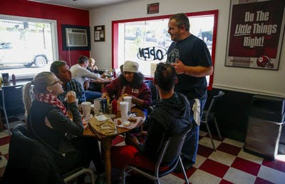Richie jokes with the Morning family, first-time customers at Hinkle's, about the size of the store's pork tenderloin. Richie himself was far from a first-time customer when he purchased the restaurant, having frequented the shop with his family since he was young.