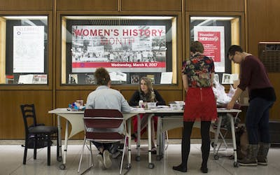 Students and faculty gather in celebration of International Womens Day Wednesday afternoon in the Herman B Wells Library lobby.