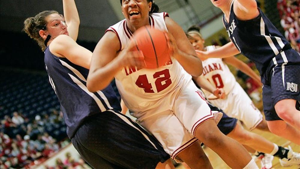 Senior forward Amber Jackson powers through two defenders during the Hoosiers 65-55 win over Penn State Thursday night at Assembly Hall.