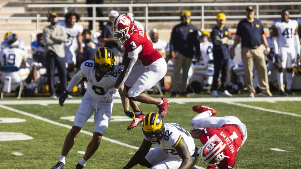 Sophomore Tiawan Mullen jumps over the Michigan offense Nov. 7 at Memorial Stadium.