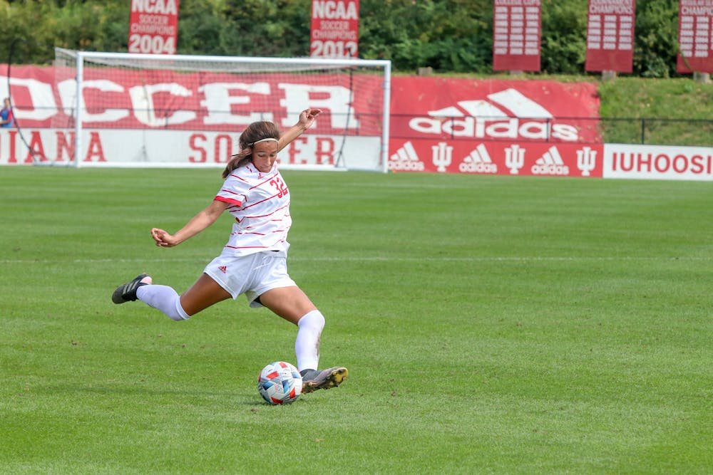 <p>Freshman defender Camille Hamm goes to kick the ball Sept. 19, 2021, in Bill Armstrong Stadium. Indiana lost 1-0 against Michigan State, bringing its record to 6-2-1.</p>