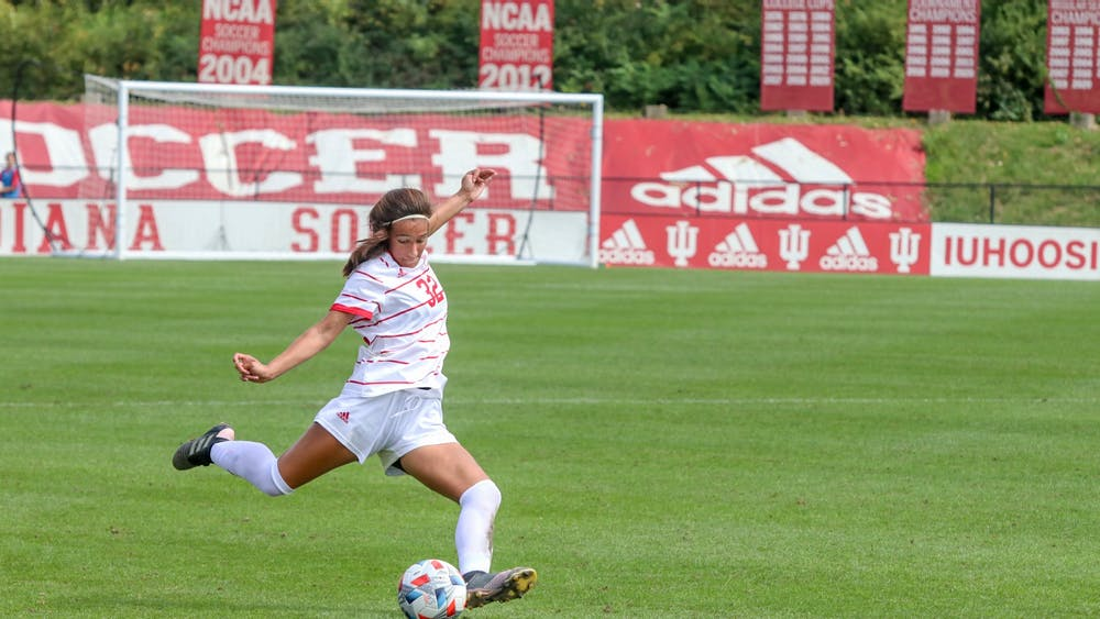 Freshman defender Camille Hamm goes to kick the ball Sept. 19, 2021, in Bill Armstrong Stadium. Indiana lost 1-0 against Michigan State, bringing its record to 6-2-1.