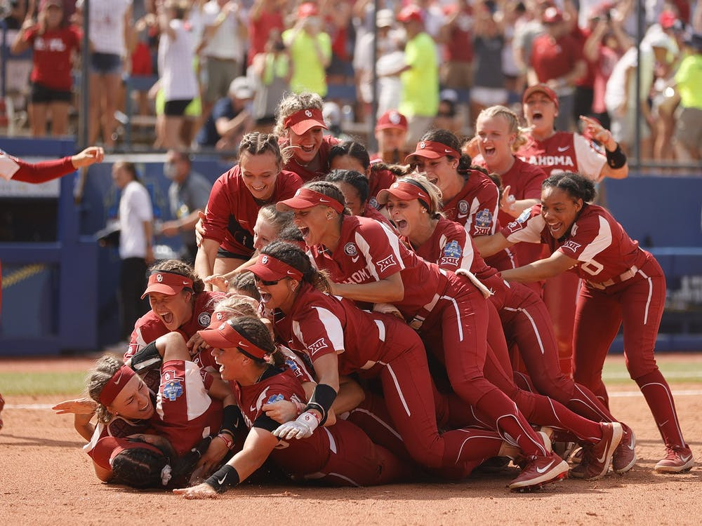 The Oklahoma Sooners dog pile on Giselle Juarez (45) after she pitched the final out to win Game 3 of the Women's College World Series Championship against the Florida St. Seminoles at USA Softball Hall of Fame Stadium on June 10, 2021 in Oklahoma City, Oklahoma. The Oklahoma Sooners won 5-1.
