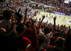 The Indiana student section reacts to a shot during the Hoosiers' game against the Iowa Hawkeyes in Simon Skjodt Assembly Hall on Dec. 4. The Hoosiers beat the Hawkeyes, 77-64.