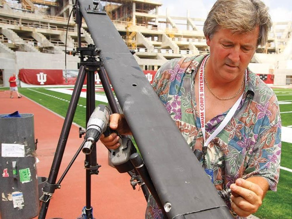 Freelance Camera Operator Chuck Goslin sets up his crane Wednesday afternoon at Memorial Stadium. Goslin is one of many camera operators that will be filming the Drum Corps International World Championship for a DVD of the event, as well as stream a live feed to movie theaters across the country for fans who can't make it to Bloomington.