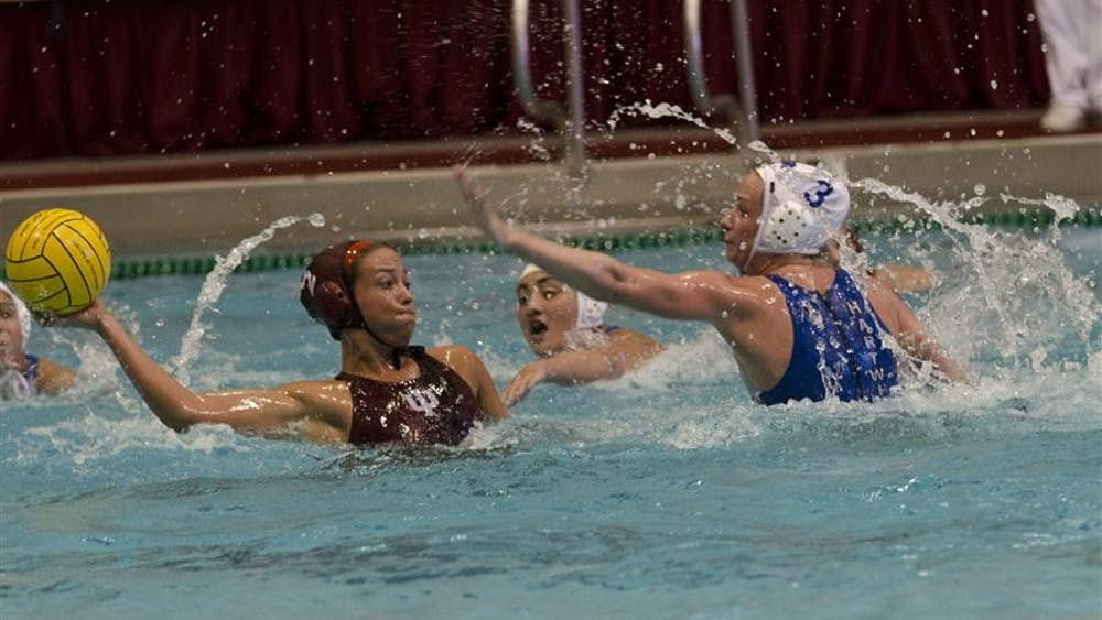 Senior utility Lauren Wyckoff prepares to pass the ball during the Hoosiers' 10-9 victory against Hartwick Saturday at the Counsilman/Billingsley Aquatic Center.