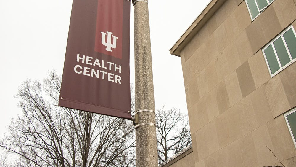 An IU Health Center sign hangs on a pole along North Jordan Avenue.The Health Center will be discontinuing preventative visits and closing the eye clinic.
