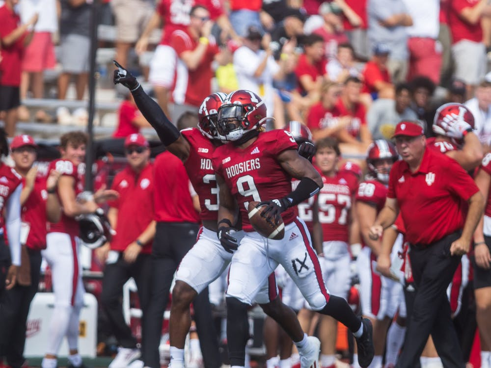 Senior defensive-back Marcelino McCrary-Ball celebrates his interception in the first quarter of the game against the University of Cincinnati Sept. 18, 2021, at Memorial Stadium. Indiana lost to Ohio State 42-35 last season.
