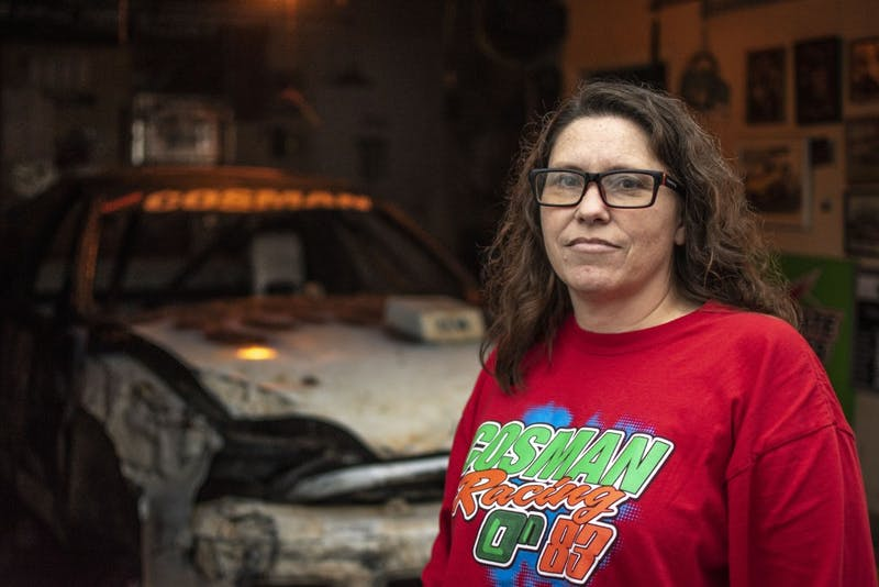 <p>Misty Cosman stands in front of her garage Feb. 4 at her home in Martinsville. Cosman, 47, has two grandchildren named Joey and Amelia.</p>