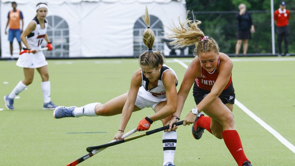 Freshman forward Hailey Couch marks her opponent to obtain the ball Friday at the IU Field Hockey Complex. The Hoosiers lost 2-1 after Louisville scored in the final seconds of the game.