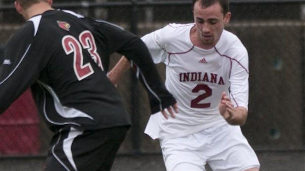 IU junior midfielder Rich Balchan dribbles against a Louisville defender on March 28 at Bill Armstrong Stadium.