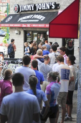 People wait in a line that stretched from the front door of Jimmy John's to the Kirkwood Hair Artists hair salon during $1.00 eight inch sub day Thursday at Jimmy John's. The $1.00 sub day was in honor of customer appreciation and took place from 11 a.m. to 3 p.m.