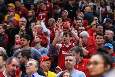 Fans cheer after IU begins to catch up to Ohio State on March 14 during the Big Ten Men's Basketball Tournament in Chicago.