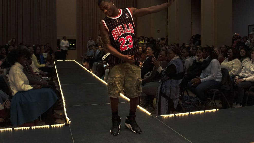 Model Austin Williams dances on the runway Jan. 31 in the Neal- Marshall Black Culture Center's Grand Hall. Williams' outfit was a part of the men's fashion segment of the Black the Runway Art Exhibit and Fashion Show.