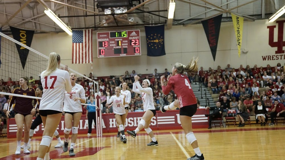 Cheers erupt from the IU women's volleyball team after scoring a point from a long volley against the Minnesota on Sept. 29. IU lost 3-0 to Nebraska on Nov. 17.