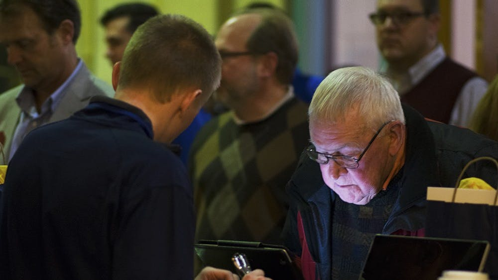 Gary Saunders, the Wayne County Republican Party chair, submits his ballot at a Congress of Counties U.S. Senate Republican straw poll on Saturday. All six Republican candidates mentioned the importance of beating Senator Joe Donnelly, D-Ind.