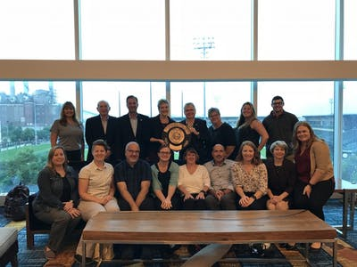 Flanked by City of Bloomington Department of Parks and Recreation staff, department Administrator Paula McDevitt and Mayor John Hamilton display the Gold Medal Award after receiving it in a ceremony in Indianapolis on Sept. 25.