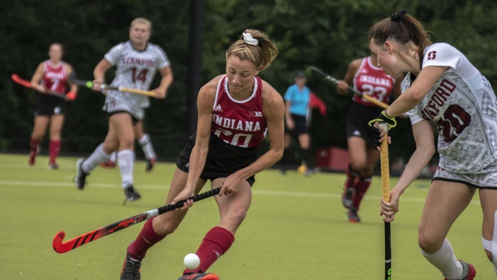 Freshman Maddie Boehm runs with the ball during Friday's match against Stanford at the Field Hockey Complex. The team's loss to Stanford brings the Hoosiers to 1-4 on the season.