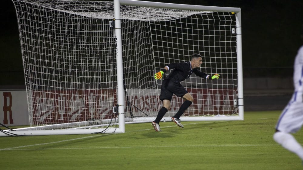 Senior goalkeeper Sean Caulfield sprints to block a ball against Pittsburgh on Aug. 30 at Bill Armstrong Stadium. IU beat Pittsburgh in double overtime, 3-2.
