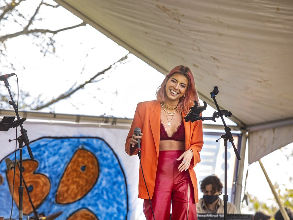 Emma Spartz sings with Bloomington Delta Music Club's Jazz Channel Thursday in Dunn Meadow. The performance was part of the club's BDMC Presents concert. CORRECTION: A previous version of this caption incorrectly listed the band's name.