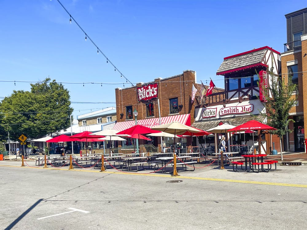<p>Empty picnic tables are seen Sept. 7, 2021, outside of Nick&#x27;s English Hut. Many small businesses in Bloomington are experiencing staffing shortages.</p>
