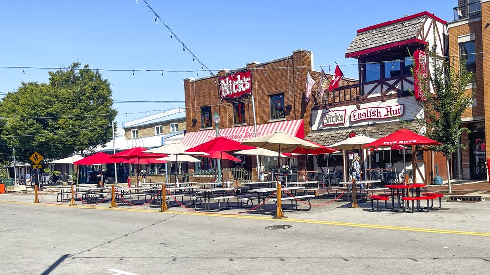 Empty picnic tables are seen Sept. 7, 2021, outside of Nick's English Hut. Many small businesses in Bloomington are experiencing staffing shortages.