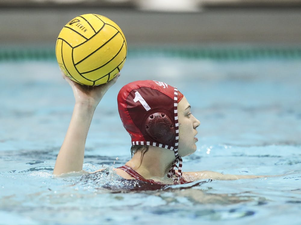 Then-sophomore goalkeeper Mary Askew makes a pass Jan. 20, 2020, in the Counsilman-Billingsley Aquatics Center. The IU water polo team will play two matches against the University of California-Los Angeles this week at home.