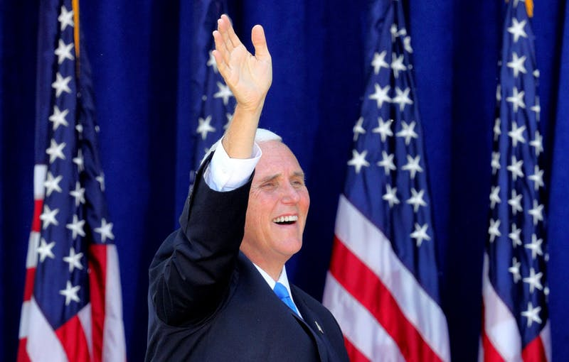 Vice President Mike Pence waves Oct. 10 to supporters at a Latinos For Trump campaign rally at Central Christian University in Orlando, Florida.