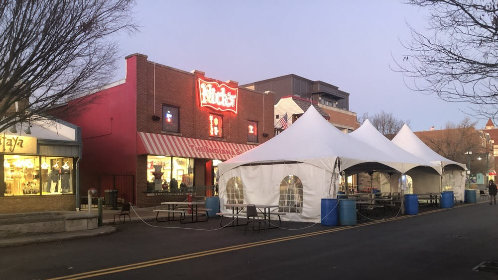 The outside seating area of Nick's is pictured. Some restaurants have added tents and heating units to their outdoor seating.