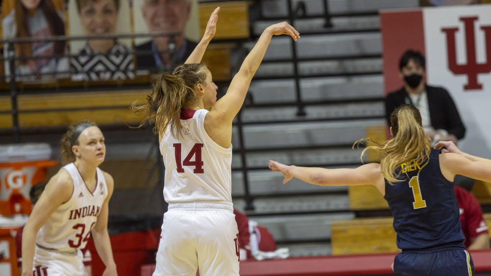 Senior guard Ali Patberg follows through her shot Thursday in Simon Skjodt Assembly Hall. No. 14 IU defeated No. 11 Michigan 70-65, led by Patberg's team-high 21 points.
