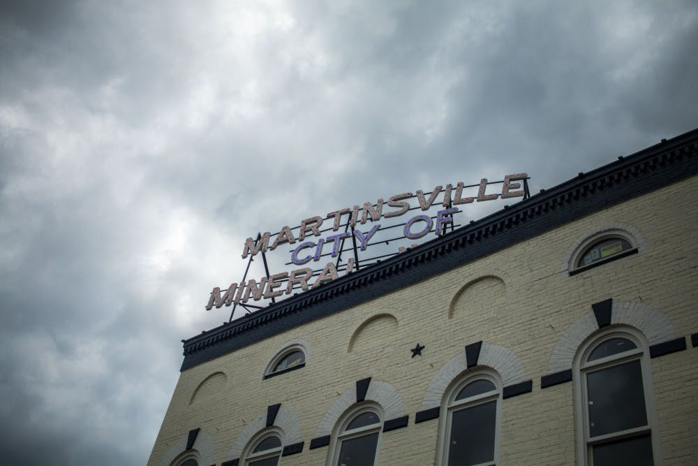 <p>A &quot;Martinsville City of Mineral Water&quot; sign sits at the top of a building on the downtown square of Martinsville, Indiana. Carol Jenkins-Davis was murdered in 1968 in the 500 block of East Morgan Street, just blocks from the square. </p>